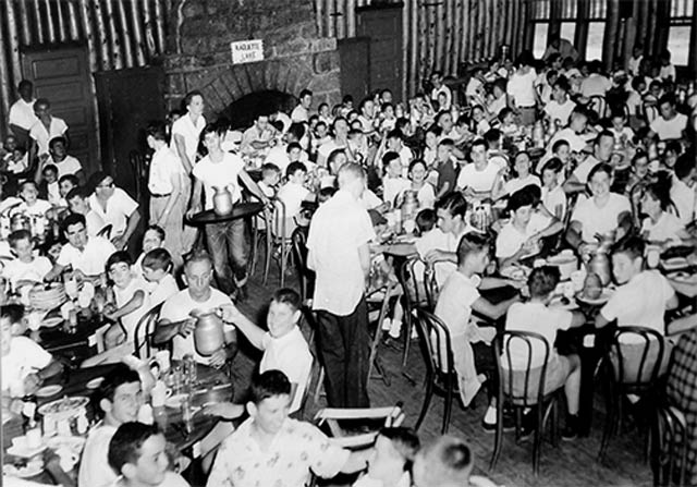 Boys enjoy a meal at the 1950s Dining Hall