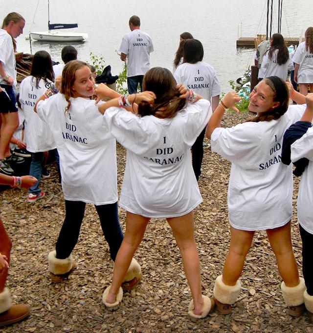 Girls wearing Saranac Trip t-shirts