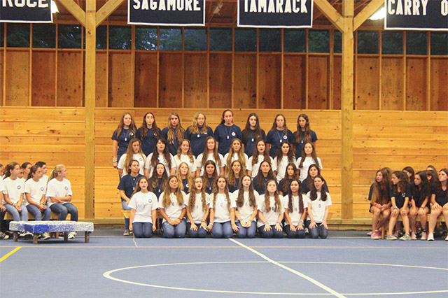 Girls gather in the arena for a singing competition during Team Week