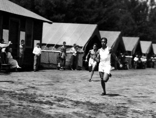 A boy running fast in the 1920s at Raquette Lake