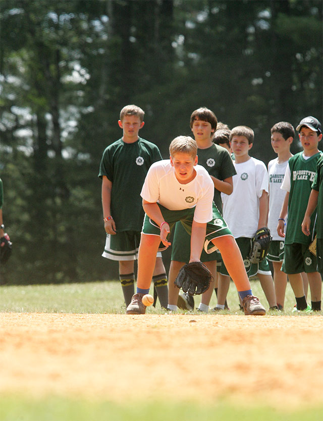 Boys play baseball on a nice summer afternoon