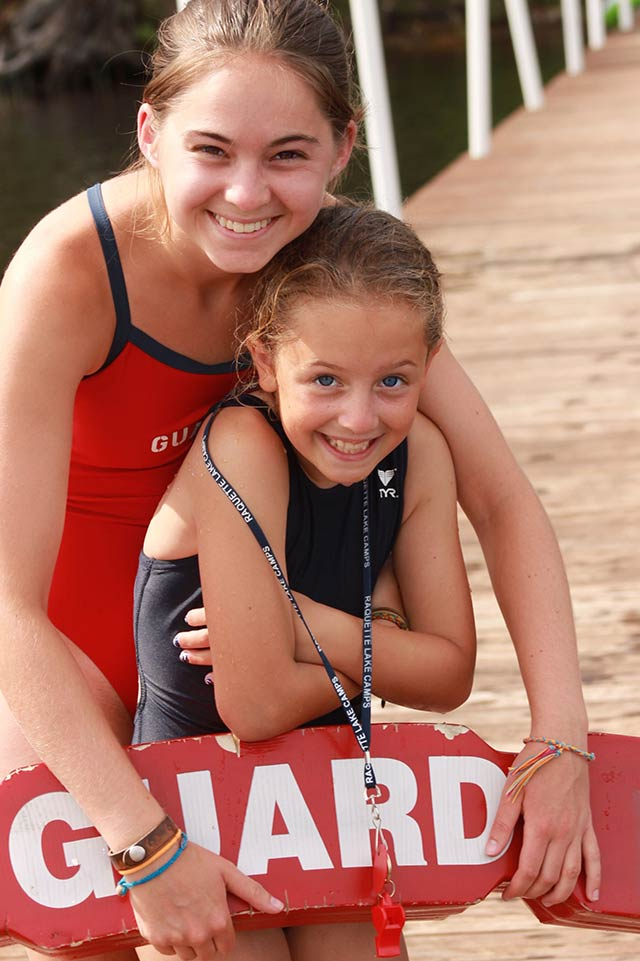 Camper and lifeguard friends