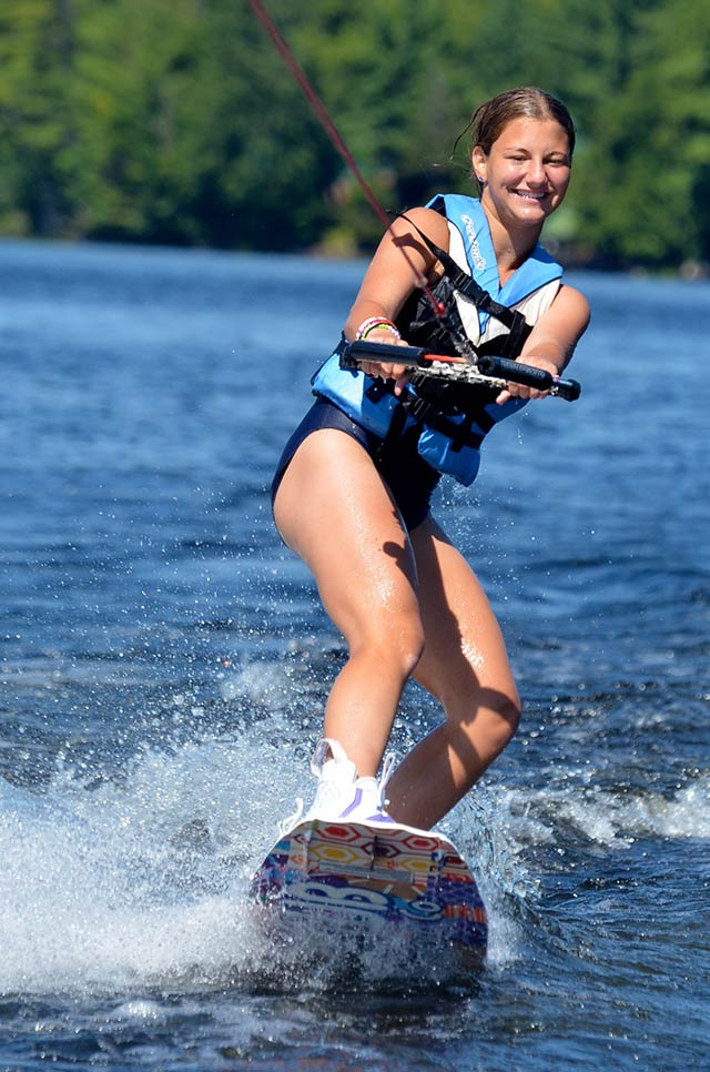 A girl wakeboarding on the lake